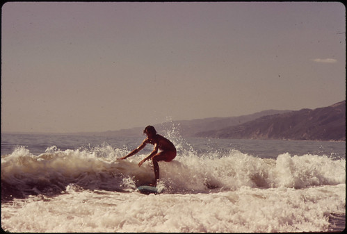 Surfing Along Malibu Beach, California. 10/1972 | by The U.S. National Archives