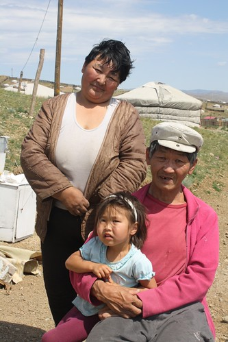 Grandparents and their granddaughter outside their ger | by East Asia & Pacific on the rise - Blog