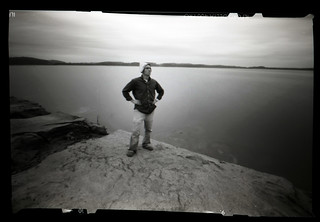 S. M. Bower Reporting Live and Un-cut from the Rising Shores of Lake Hartwell SC, Poising Pensively (Perhaps Triumphantly) with a Newspaper Sailor Sombrero | by S. M. Bower (yo soy el pinhole caballero)