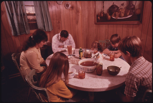 The Wayne Gipson Family Says a Prayer before Their Evening Meal in the Kitchen of Their Modern Home near Gruetli, near Chattanooga, Tennessee 12/1974 | by The U.S. National Archives