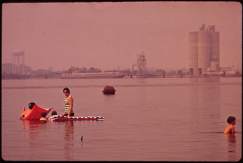 Swimming in Polluted Lake Charles. Olin-Mathieson Plant in Background 06/1972 | by The U.S. National Archives