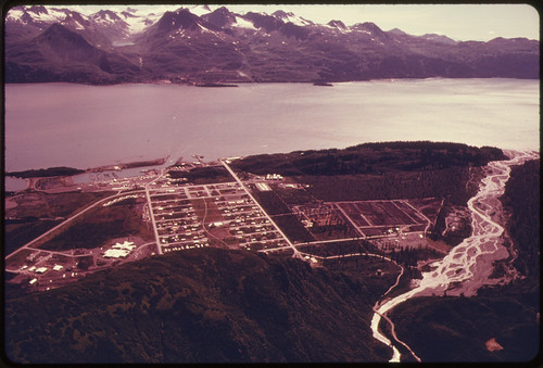 View South Across Port Valdez From New Townsite to Pipeline Terminus and Site of Deepwater Tanker Loading Facilities...08/1974 | by The U.S. National Archives