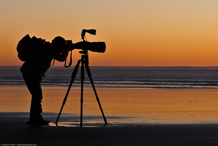 Student shown here in silhouette.  Arthur Morris leads an advanced Instructional Photo Tour class on Morro Strand State Beach 13 Jan. 2009 | by mikebaird