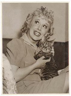 Comedian Violet Carlson and cat in the dressing room, Sydney, 1930's / Sam Hood | by State Library of New South Wales collection