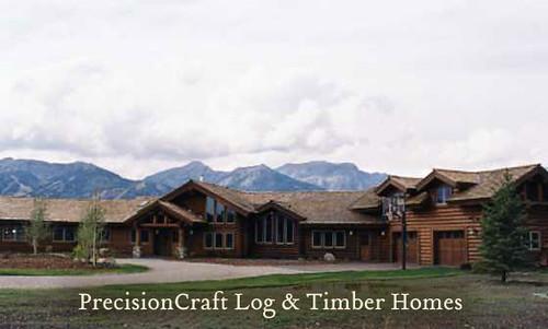 Custom wyoming log home exterior by precisioncraft log for Custom home builders wyoming