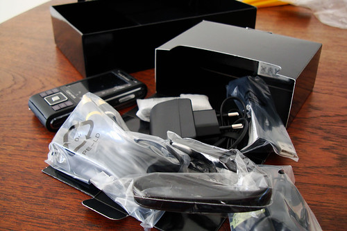 Unboxing the Sony Ericsson C905 mobile phone. A data cabl ...