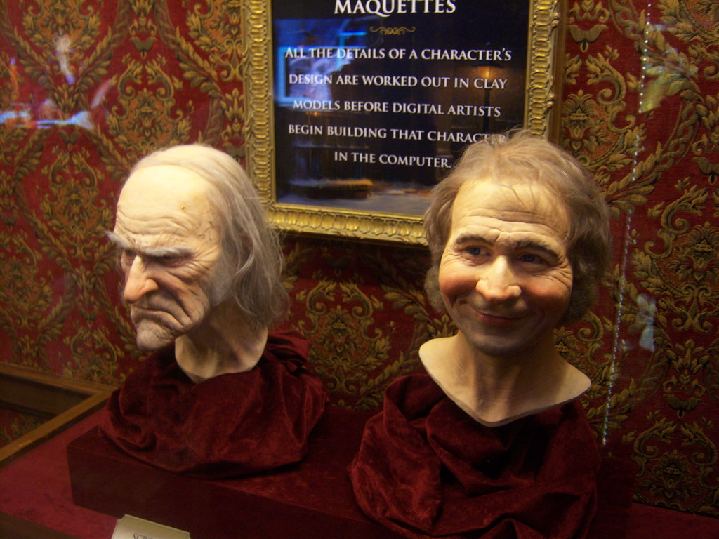scrooge and bob cratchit head maquettes at disneys a christmas carol train tour by castles - A Christmas Carol Disney