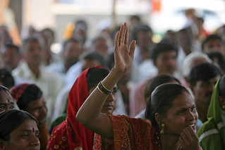 A woman raises her hand to speak at a community meeting in Aurangabad | by World Bank Photo Collection