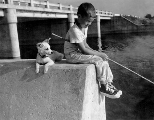 Young boy fishing with his dog: Palm Beach County, Florida | by State Library and Archives of Florida