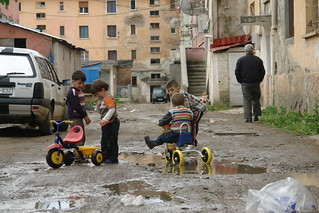 Tricycles in the puddles in Peshkopi | by CharlesFred
