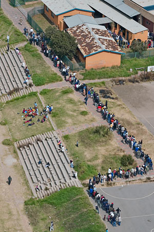 South Africans lined up in Johannesburg for up to eight hours to cast their ballots in the April 22 national elections. The ruling ANC did not maintain its two-thirds majority in the parliament with Jacob Zuma as the new president-elect. | by Pan-African News Wire File Photos