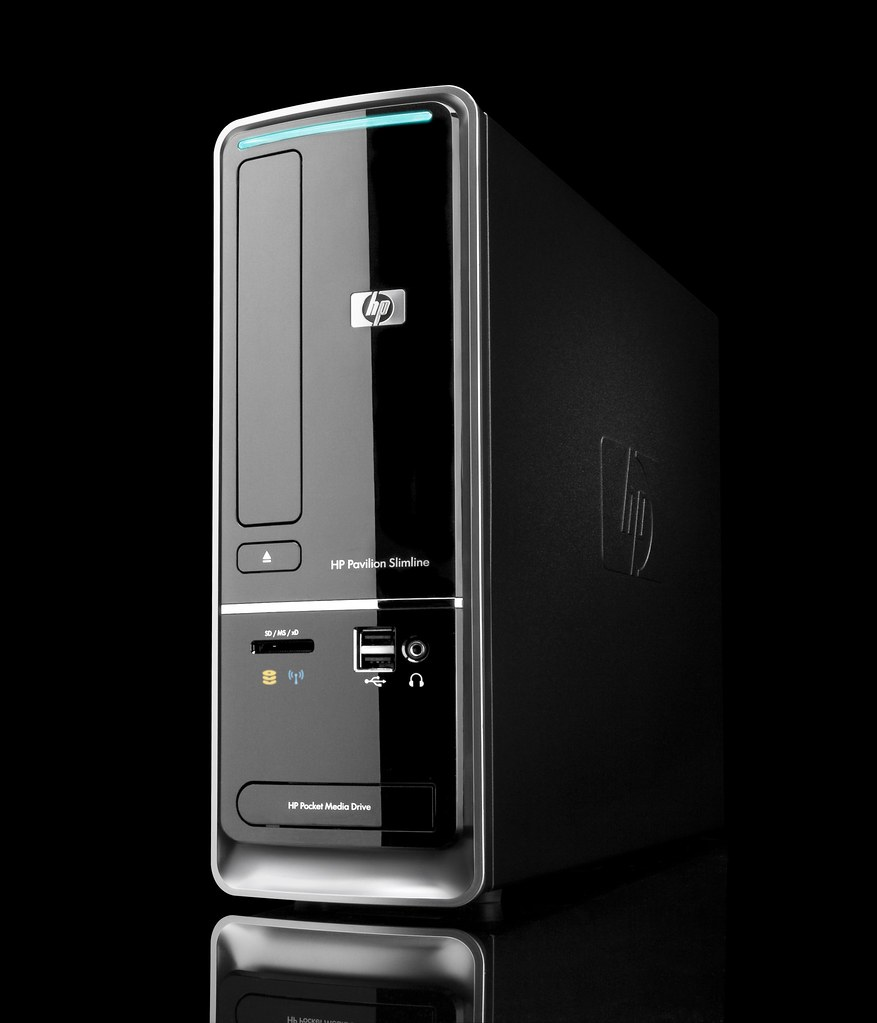 ... Left view of HP Pavilion Slimline s5000 on black background | by HP  Hewlett-Packard