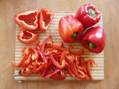 sliced red bell peppers | by Emily Barney