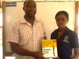 Ikalumhe Lazarus collects his book from Doyin Asaju of Jidaw at the FREE IT Career Seminar for February 2009 in Lagos, Nigeria | by Jidaw