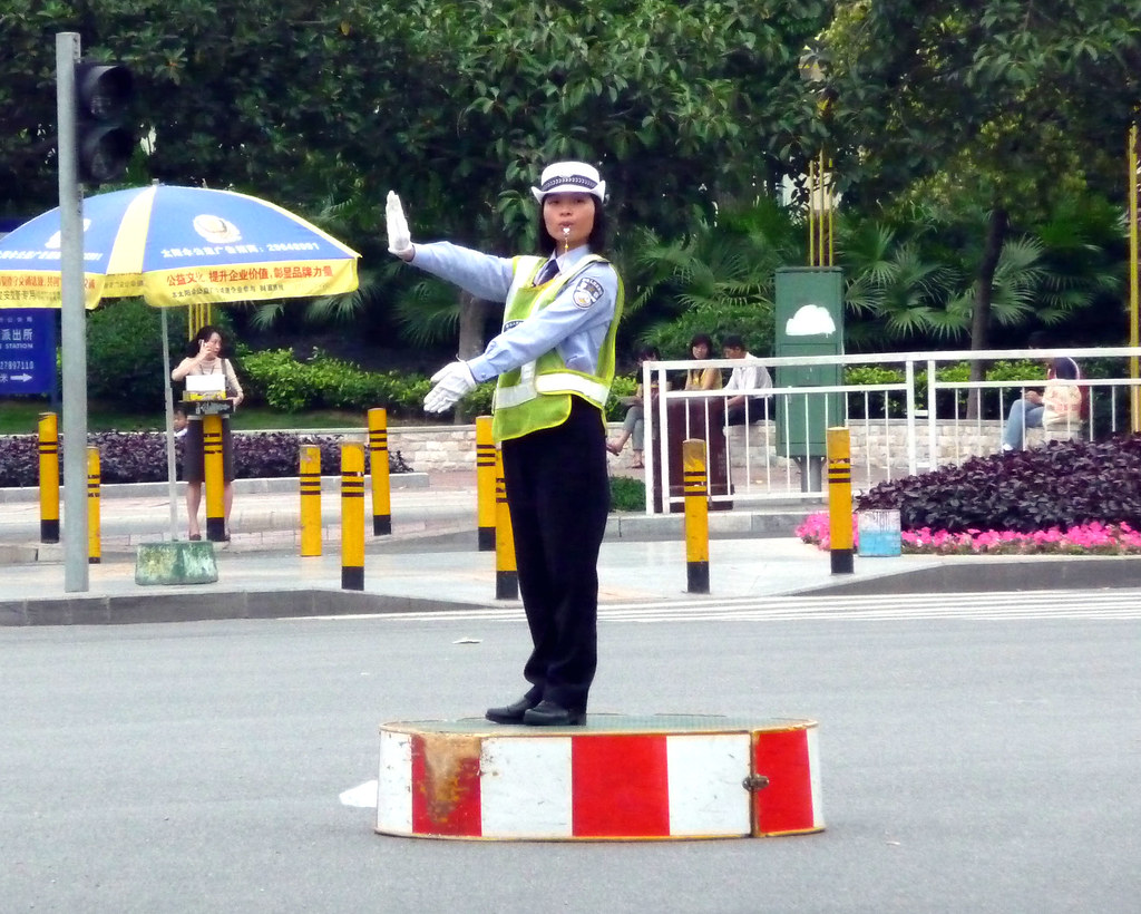 chinese policewoman directing traffic at junction chris flickr