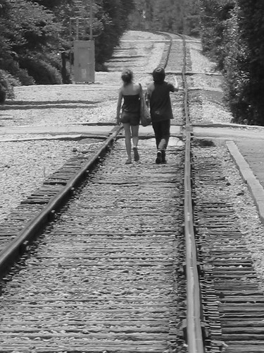 Alone on their journey - (Black and White)   A young ...