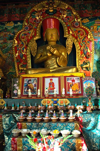 sakya pandita statue with altar offerings  gilt  semi