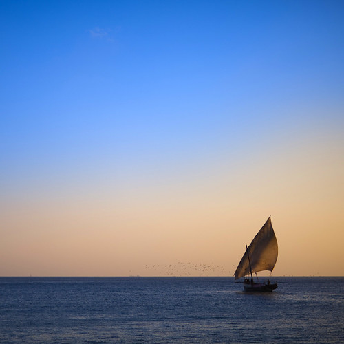 Tanzania, Zanzibar, Kizimkazi, traditional dhow at sunset | by Eric Lafforgue
