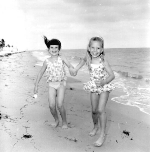 Two friends having fun modeling swimwear at the beach | by State Library and Archives of Florida