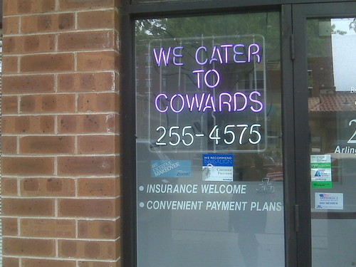"Dentist sign: ""we cater to cowards"" 