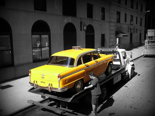 yellow taxi black and white new york city man. Black Bedroom Furniture Sets. Home Design Ideas