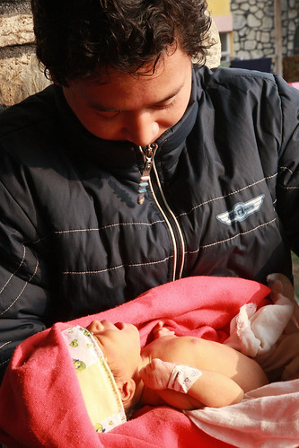 Man holds his newborn baby | by World Bank Photo Collection