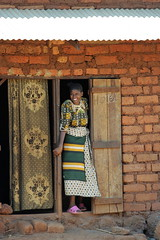 Woman at Her House in Tanzania | by United Nations Photo