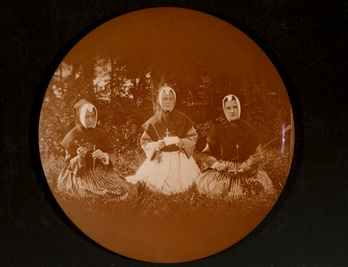 Three nuns seated on grass | by George Eastman Museum