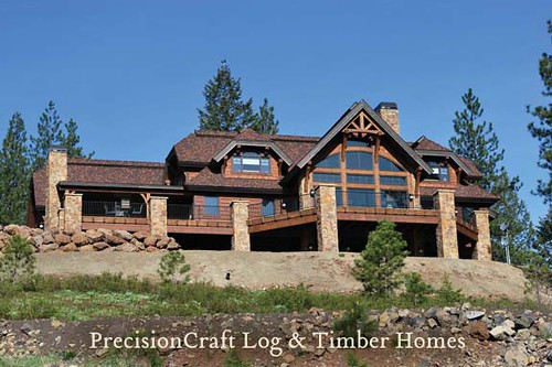 Exterior view of custom timber frame home by precisioncr Timber house