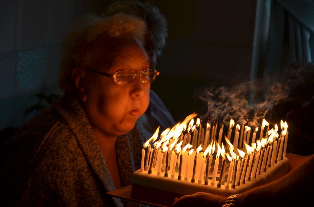 Gran Blows Out Her Candles On 80th Birthday Cake