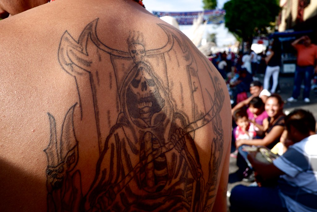 Santa Muerte tattoo at her shrine in Tepito, Mexico City | Flickr