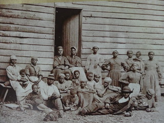Slaves during slavery in the South. Photograph display on Gullah culture at Boone Hall Plantation. | by denisbin