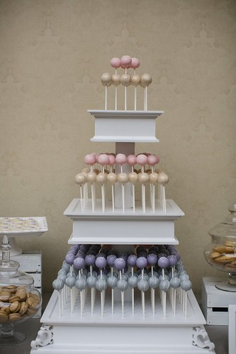 Our three tiered white stand filled with yummy cake pops is a great alternative to a traditional cake | by Sweet Lauren Cakes