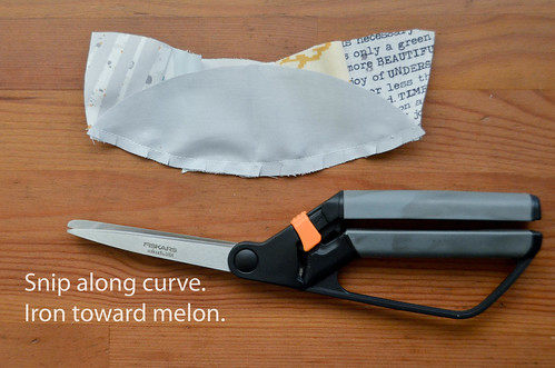 11. Scant snips along seam to make ironing easier. Iron toward melon.