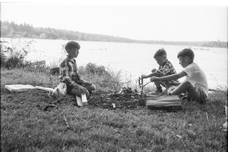 Boys around a campfire by the water. | by simpleinsomnia