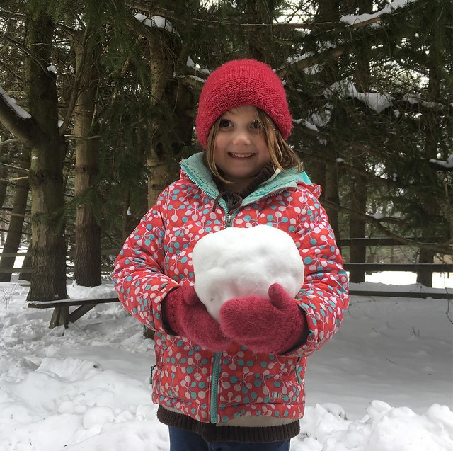 A girl and her giant snowball.