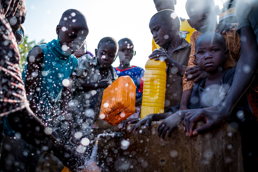Internally Displaced People fill containers with water at a tap inside the Dalori camp in Maiduguri, Borno State, Nigeria, Friday 3 March 2017...The prolonged humanitarian crisis in the wake of the Boko Haram insurgency has had a devastating impact on foo