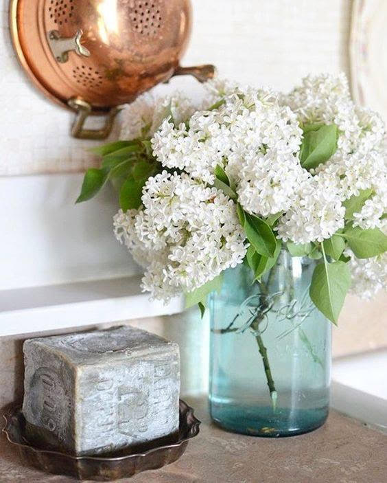 White Flowers in Antique Blue Vase
