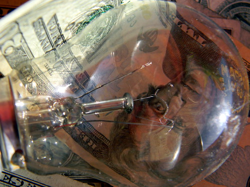 Cost of electricity incandescent light bulb dollar us note flickr Cost of light bulb