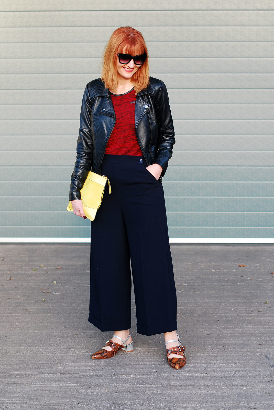 Corporate rock chic look: Black biker jacket \ red textured t-shirt \ navy culottes \ Finery pointed strappy snakeskin buckle shoes \ neon yellow suede clutch | Not Dressed As Lamb, over 40 style
