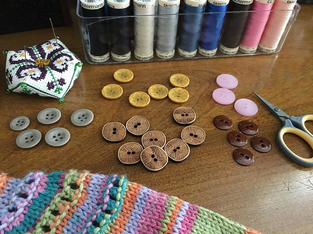 Final button choices. Make it work. #knitting #buttons