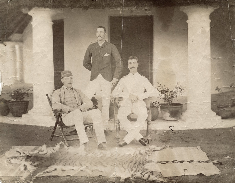 Three men posing with a tiger skin. India or Burma?