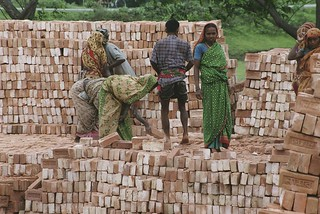 Stacking bricks | by World Bank Photo Collection