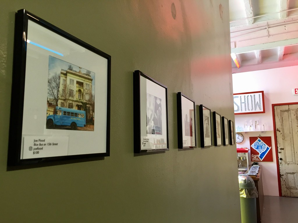 photos hanging at Capital Fringe