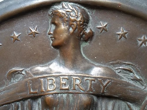 Liberty Trust Company plaque closeup head