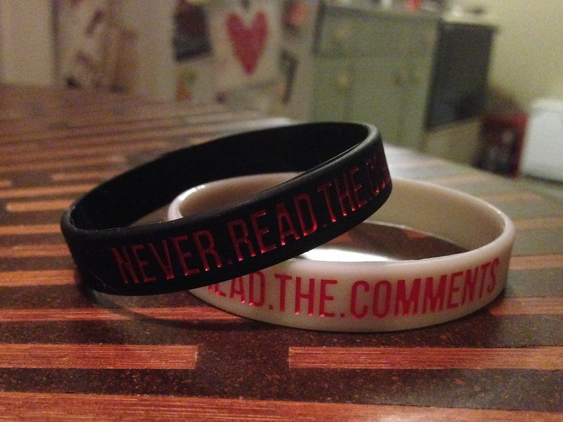 """never read the comments"" bracelet. image credit: jessamyn west CC: by-nc-sa https://www.flickr.com/photos/iamthebestartist/11409781184"