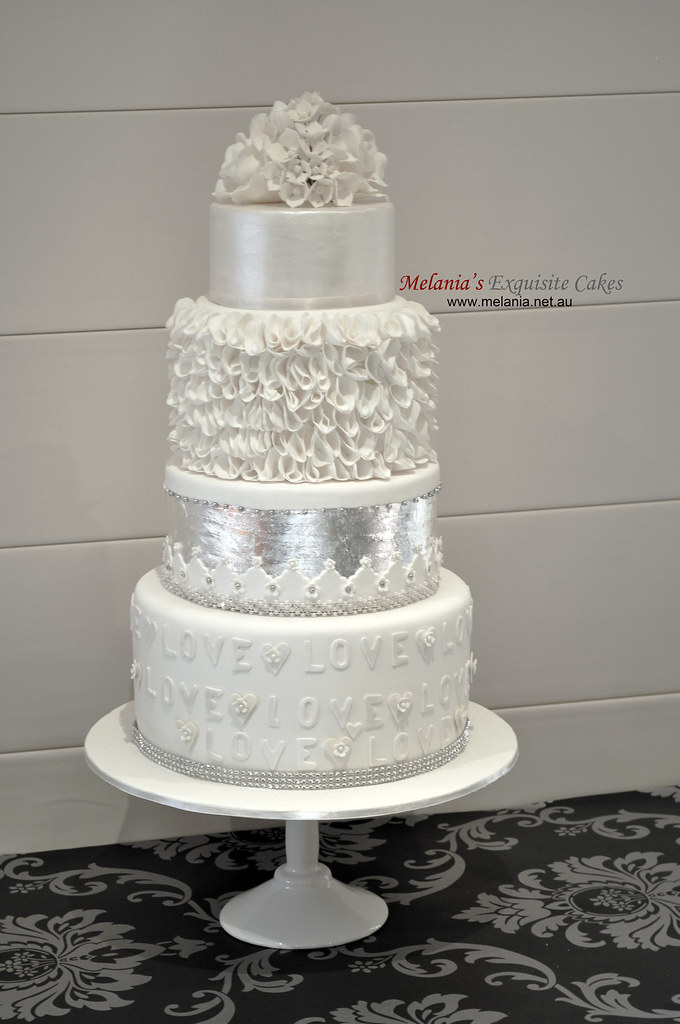 white wedding cake with silver leaf, lustre, ruffle and su…   Flickr