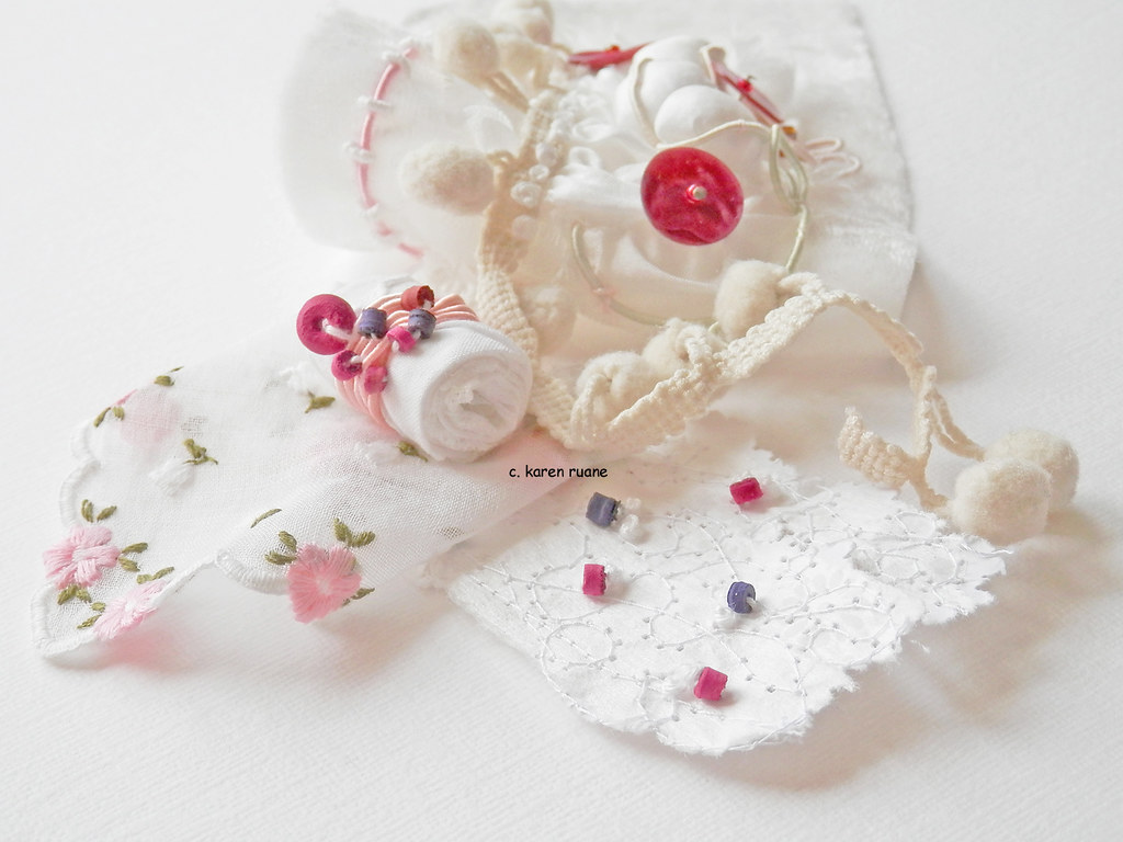 Silk Paper Embroidery Beads Pom Poms And A Toggle Flickr