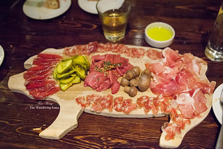 Charcuterie on a wooden pig-shaped tray | by thewanderingeater