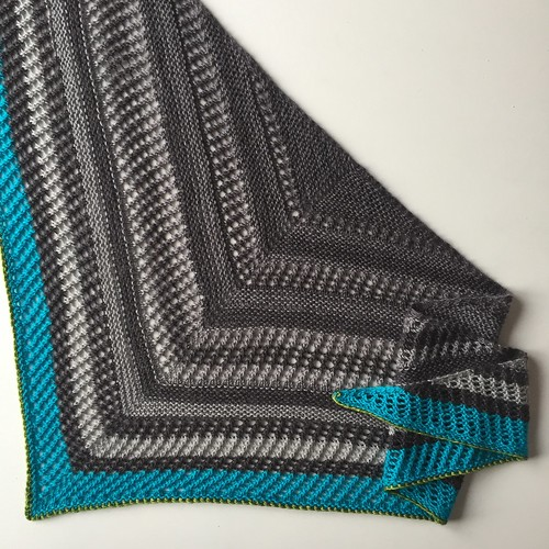 Reyna shawl made with Green Caterpillar shawl striping MCN in Fade to Blue
